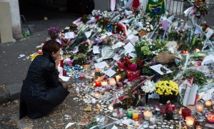 PARIS, FRANCE - NOVEMBER 16: A woman mourns the victims near the Bataclan concert hall on November 16, 2015 in Paris, France. A Europe-wide one-minute silence was held at 12pm CET today in honour of at least 129 people who were killed last Friday in a series of terror attacks in the French capital. (Photo by David Ramos/Getty Images)